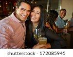 couple enjoying drink at bar... | Shutterstock . vector #172085945