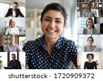 Small photo of Smiling young indian female employee talk speak on video call with diverse colleagues, multiracial coworkers employees have webcam conference using modern app, engaged in web online briefing