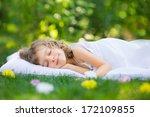 happy kid sleeping on green... | Shutterstock . vector #172109855