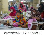Small photo of Laborer's wearing face-masks working in a garment factory as government has eased restriction on garment factories during coronavirus outbreak in Dhaka on May 03, 2020.