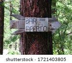 Weather Beaten Wooden Sign In...