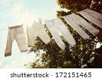 Stock photo row of baseball pants hanging up to dry 172151465
