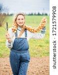happy girl farmer in a field in ...