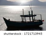 Silhouette Of A Fishing Boat...