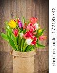 tulips in the sack on wooden... | Shutterstock . vector #172189742