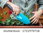 Woman Is Using Shovel For...