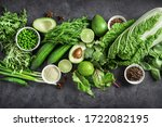 Small photo of Top view of healthy organic food: green vegetables, seeds and herbs on dark background. Source of protein for vegetarians.