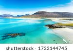 A beautiful sunny morning looking out over the sandy beaches to Luskentyre from Seilebost on the Isle of Harris in the Outer Hebrides of Scotland