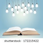 open book with shining lamps | Shutterstock . vector #172215422