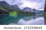 Mountains And Moraine Lake At...