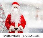 Santa Claus Wearing A Mask...