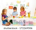 Kindergarten Kids By The Table...