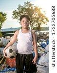 Portrait Of An Asian Boy Who...