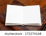 open book on wooden table | Shutterstock . vector #172274168