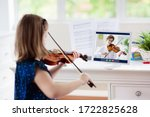 Child Playing Violin. Remote...