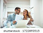 Small photo of Shot of a young couple using a laptop while working on their home finances. Making home financial management simpler with modern technology. Doing their best to budget wisely