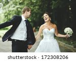newly wed couple going crazy.... | Shutterstock . vector #172308206