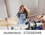 Teenage Girl Playing Drums In...