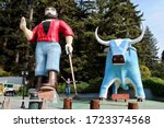 Small photo of Klamath, California - 2017: Paul Bunyan and Babe the Blue Ox statues at Trees of Mystery. 49-foot statue of Paul Bunyan and 35-foot statue of Bunyan's companion Babe the Blue Ox, visible from US 101.