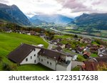 Scenic aerial view of hillside villages in Triesenberg and the river Rhine, natural border of Liechtenstein, an alpine country in central Europe, to Switzerland