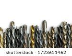 Used and rust specked twist drill bits on white background with copy space - stock photo