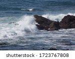 Ocean Surf Against The Rocks