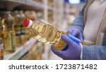 woman in medical gloves chooses ... | Shutterstock . vector #1723871482