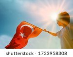 Young Boy Holding Turkish Flag.