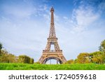 Small photo of Eiffel Tower on blue sky background in summer sunny day. View on Eiffel tower from Mars fields without tourists. Sunny Paris cityscape.