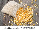 Corn In Burlap Bag On Wooden...
