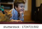 funny child with kitten using a ...   Shutterstock . vector #1724721502