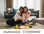 two asian women drink orange... | Shutterstock . vector #1725304402