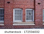 Windows from an abandoned World War II factory - stock photo