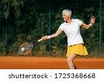 Smiling Elderly Woman Playing...
