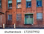abandoned WWII red brick factory in Martinsburg, WV - stock photo
