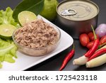 canned tuna in glass bowl with...