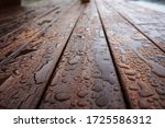 Drops Of Water On A Wooden...