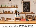 cafe owner in medical mask... | Shutterstock . vector #1725645658