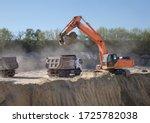 Huge Orange Crawler Excavator...