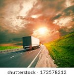 trucks under colorful sky | Shutterstock . vector #172578212