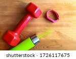 Small photo of Red dumb bells with digital sport tracker and solid sports water bottle