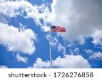 American Flag Flying In The...