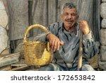 Senior Farmer Holding A Basket...