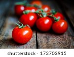 Tomatoes On The Vine On Rustic...