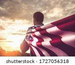 Attractive Man Holding Flag Of...