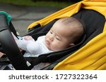 asian baby sleep inside stroller | Shutterstock . vector #1727322364