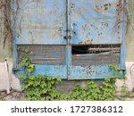 Old Metal Door To An Abandoned...