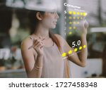 Small photo of A woman presses a button to evaluate services for online shopping on a virtual touch screen .Customer service evaluation concept