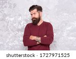 Small photo of Tattooed macho. Manhood. Good looking guy. Grow facial hair. Hipster appearance. Stylish beard and mustache. Beard fashion and barber concept. Man bearded hipster. Barber tips maintain beard.