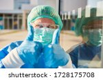 Nurses In Protective Clothing...